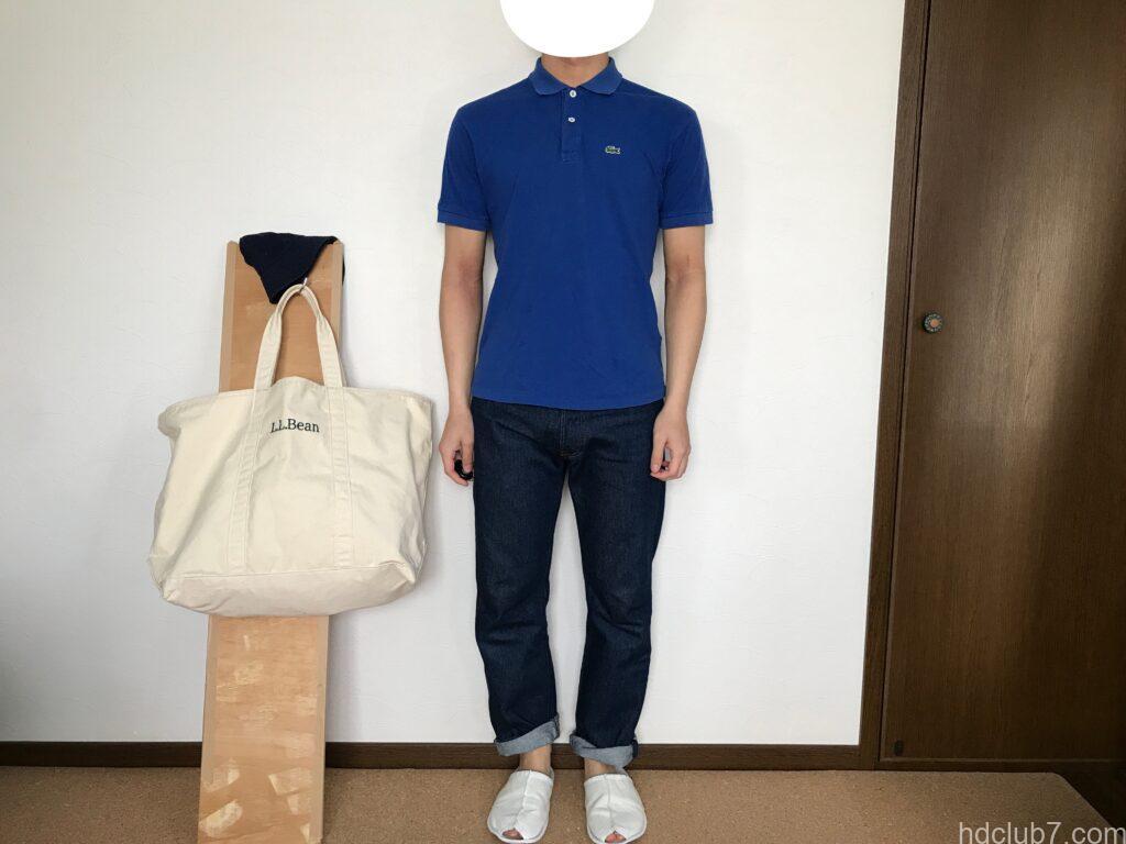 ラコステのポロシャツのボーイズモデルL1812とリーバイス501を着た人