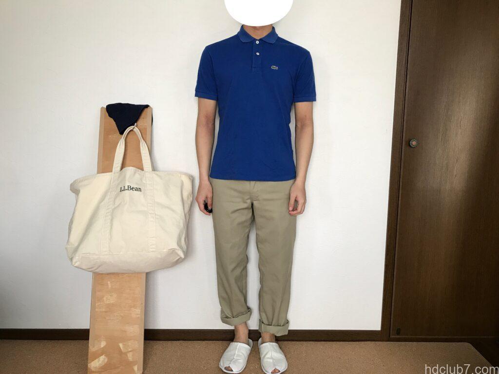 ラコステのポロシャツのボーイズモデルL1812とディッキーズ874を着た人