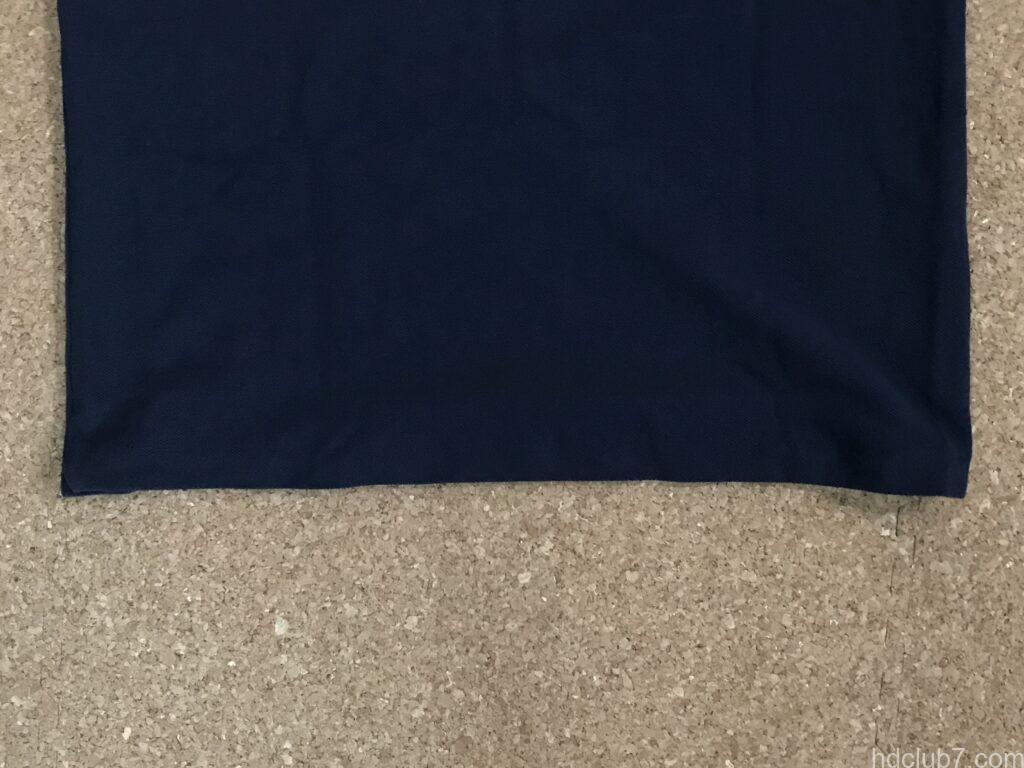 裾が縫い終わったラコステのポロシャツL1212の後ろ