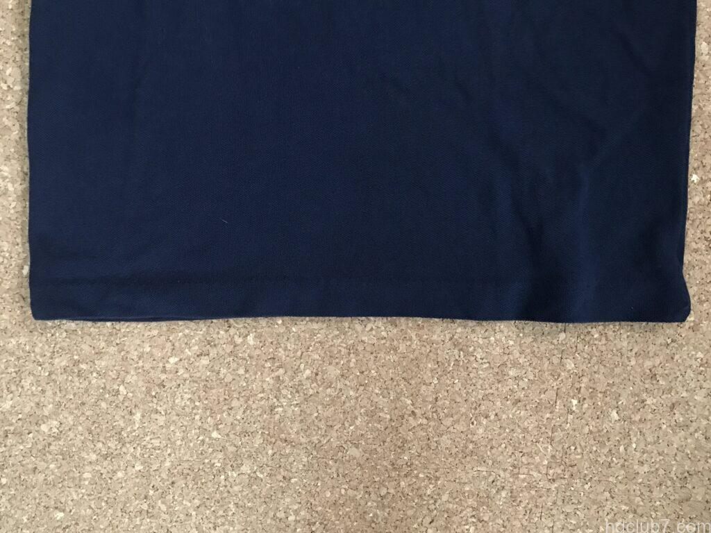 縫い終えたラコステのポロシャツL1212の前裾
