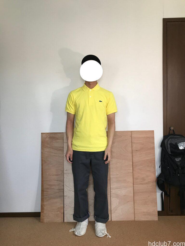 5度洗濯したラコステのポロシャツL1212のサイズ2とディッキーズ874を着た人
