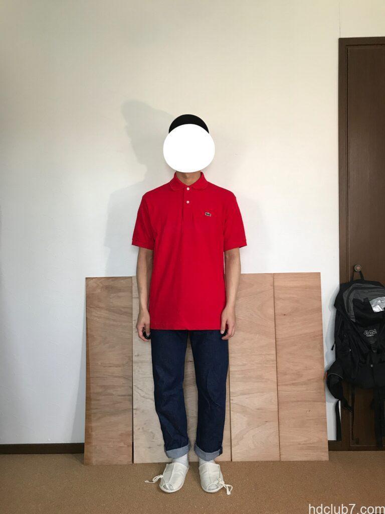 3度洗濯したラコステのポロシャツL1212のサイズ5とリーバイス501を着た人